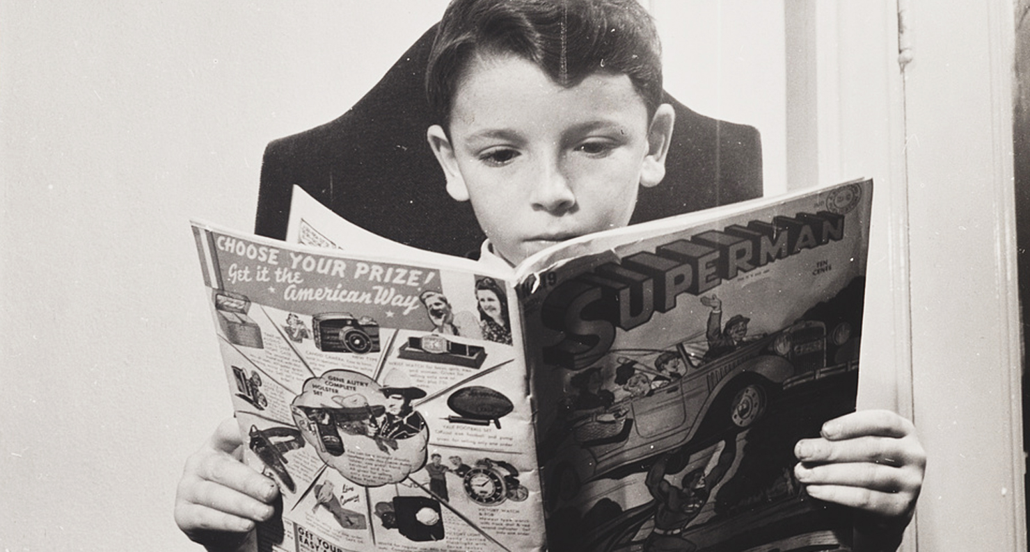 A German refugee child reads a Superman comic, 1942