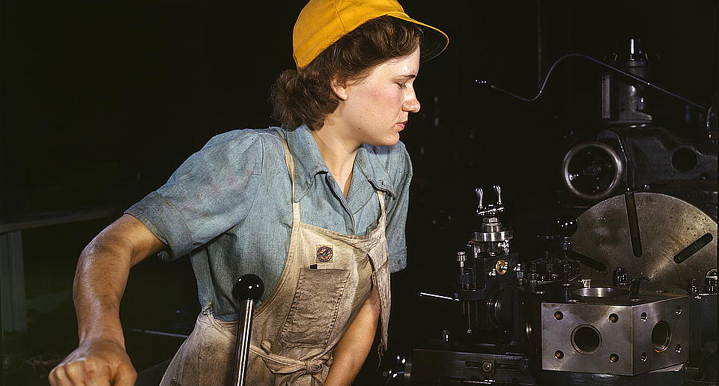 Lathe operator machining parts for transport planes at the Consolidated Aircraft Corporation plant, Fort Worth, Texas