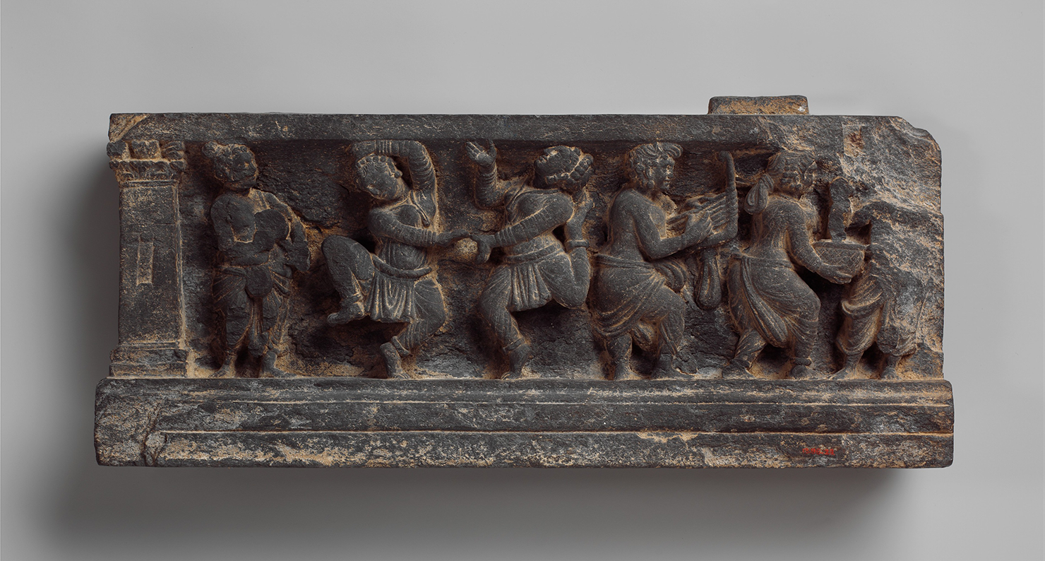 Dionysian scene with musicians and dancers, stair riser, Pakistan, first century. The Metropolitan Museum of Art.
