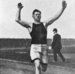A black and white photograph of a man, Jim Thorpe, running.