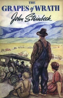 Book cover of The Grapes of Wrath. A family looks out on a road through a green field as a line of cars, all packed full, makes its way down the road.