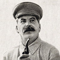 A black-and-white photograph of Joseph Stalin wearing a cap