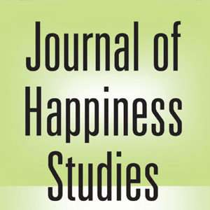 A detail from the cover of the Journal of Happiness Studies. A green background with black text that reads Journal of Happiness Studies.