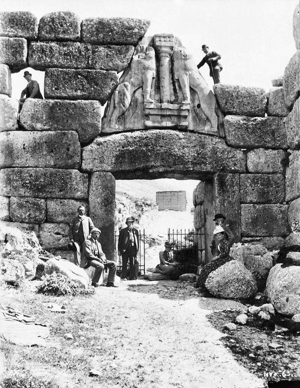 Wilhelm Dörpfeld (upper left) and Heinrich Schliemann (upper right) at the Lion Gate of Mycenae, c. 1884–85.