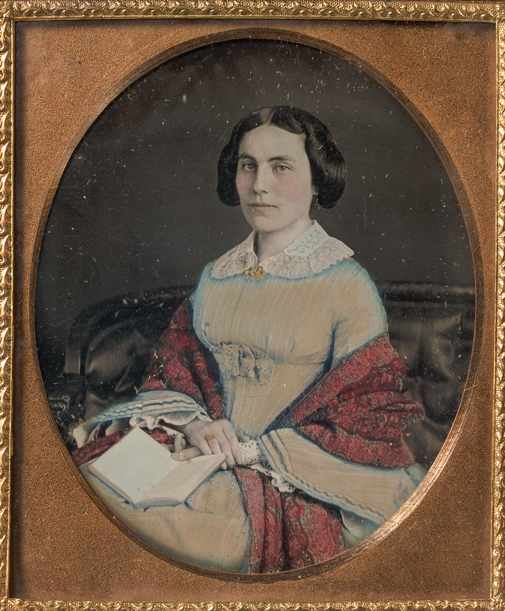 Seated young woman wearing a shawl, holding an open book in her lap, c. 1850. The Metropolitan Museum of Art, Bequest of Herbert Mitchell, 2008.