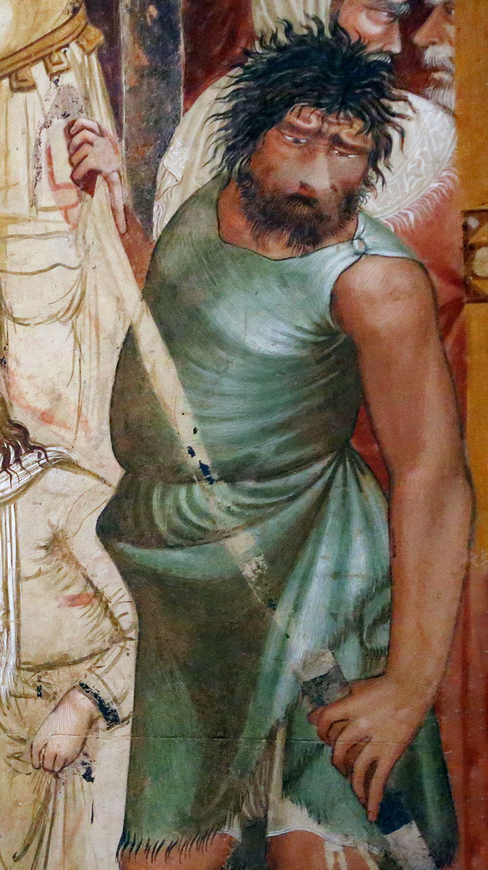 Detail of an executioner from The Martyrdom of the Franciscans, fresco by Ambrogio Lorenzetti, c. 1330. Photograph by Saliko. Wikimedia Commons.