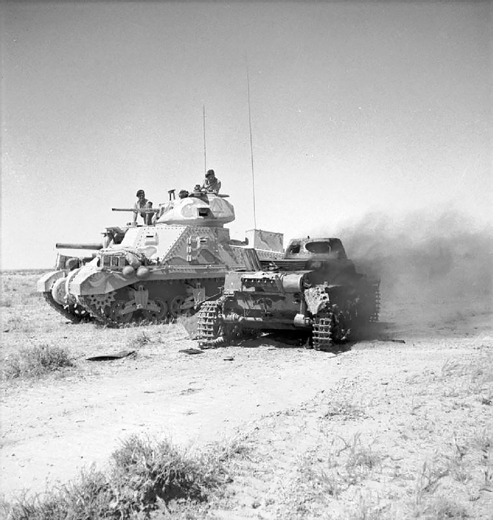A British M3 Grant tank next to a knocked-out German Panzerkampfwagen I light tank in North Africa, June 6, 1942. © Imperial War Museums.