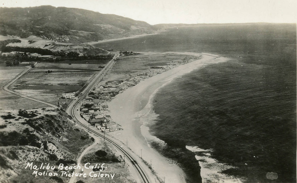 Aerial photograph of the Malibu Movie Colony and the Malibu Pier beyond, 1930s.