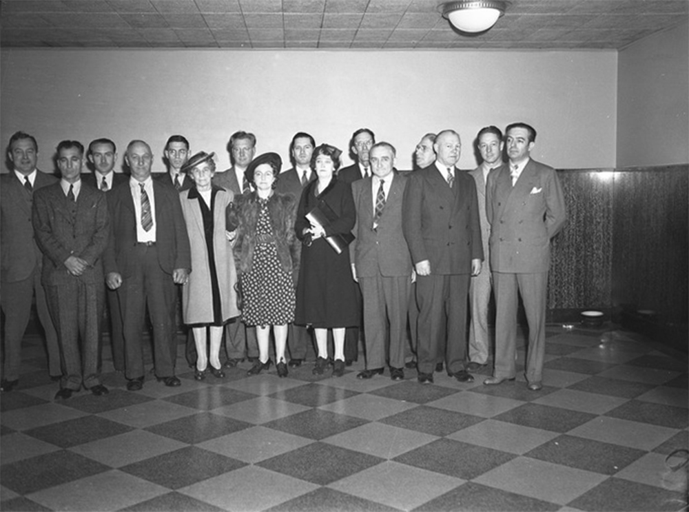 Sixteen members of Mankind United at a sedition-conspiracy trial in Los Angeles, 1942. UCLA, Charles E. Young Research Library, Department of Special Collections, Los Angeles Daily News Negatives (CC BY 4.0).