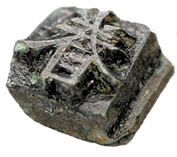 A piece of movable type with a Chinese glyph