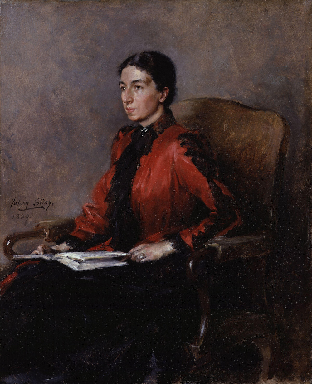 A portrait of Mary Augusta Ward seated, wearing a red dress and holding a book.