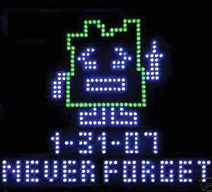an LED image of a robot and the words never forget.