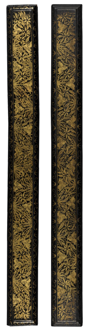 A binding for a Thai palm-leaf manuscript, a Royal edition of Pannasa Jatakas. The binding is long thin strips of wood lacquered in black and ornately covered in gold-leaf vines, leaves, and fruit.