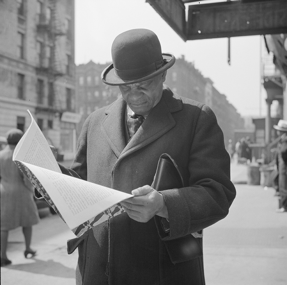 A Marcus Garveyite reading the OWI publication Negroes and the War, 1943. Photograph by Gordon Parks. Library of Congress, Prints and Photographs Division.