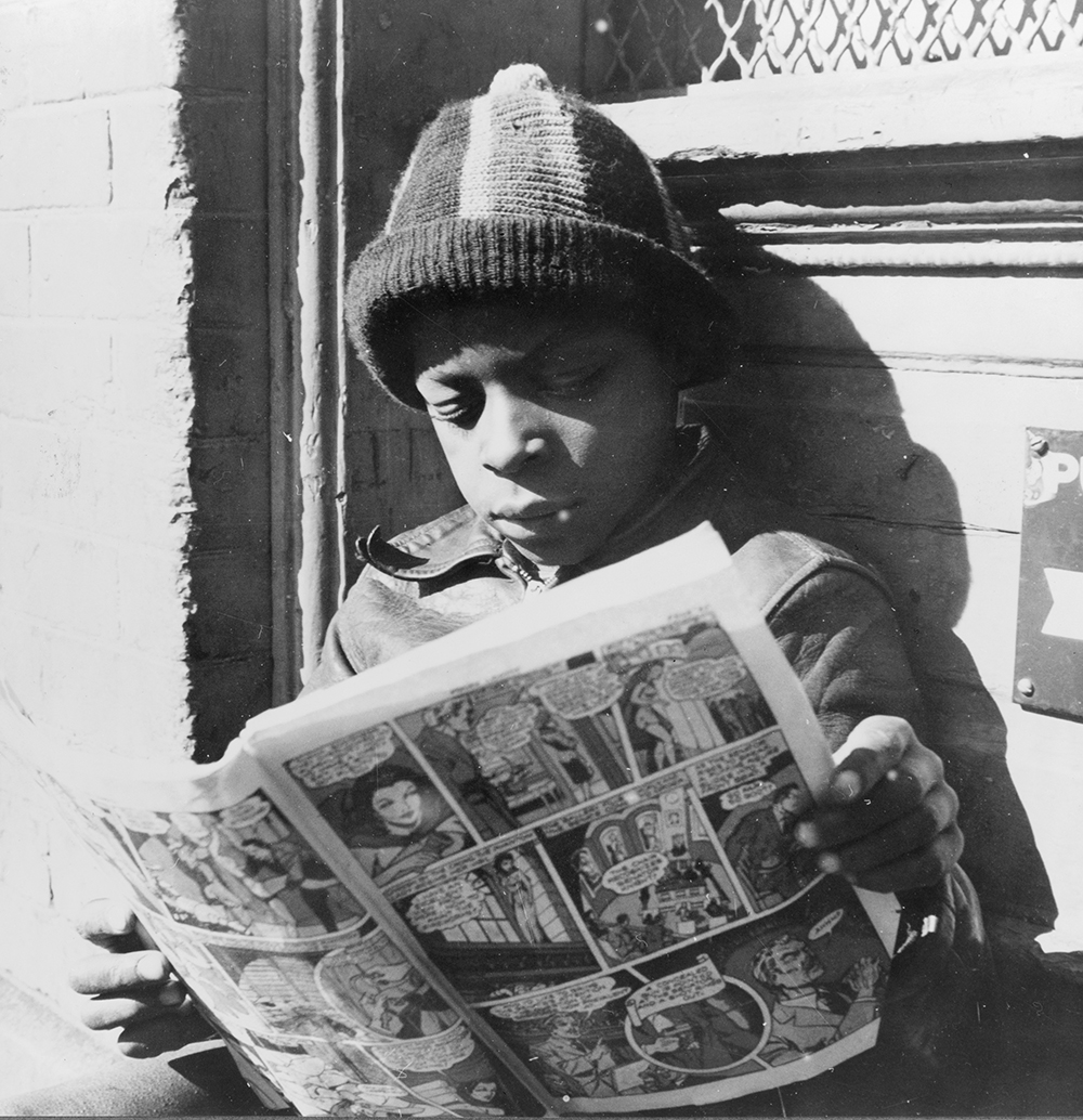 Child reading a funny paper on a doorstep in the Southwest section of Washington, DC, 1942. Photograph by Gordon Parks. Library of Congress, Prints and Photographs Division.