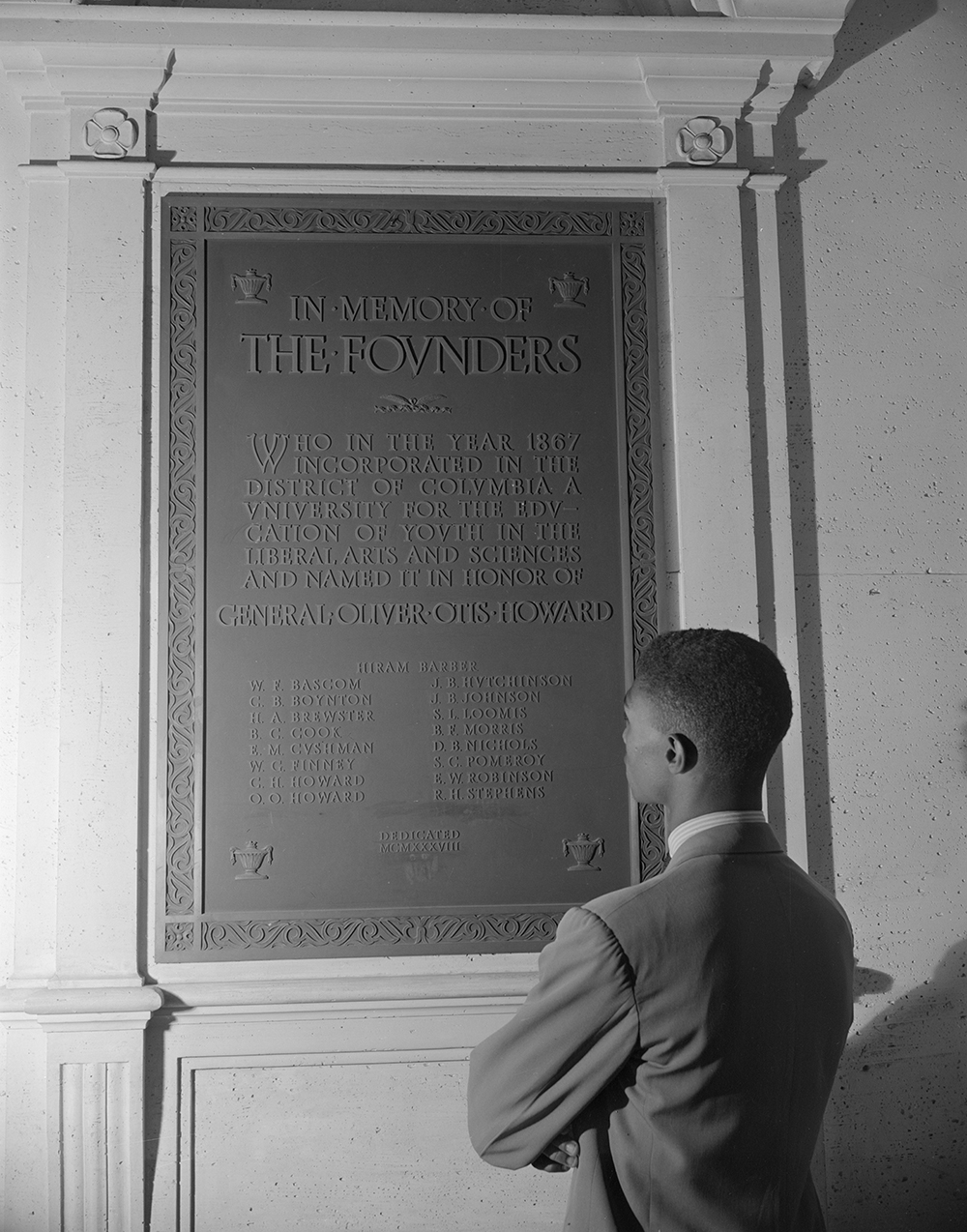 Student reading bronze plaque in the Founders Library, Howard University, Washington, DC, 1942. Photograph by Gordon Parks. Library of Congress, Prints and Photographs Division.