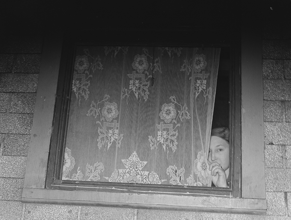 Photograph of prostitute at window in Peoria, Illinois, 1938, by Arthur Rothstein. Library of Congress, Prints and Photographs Division, Office of War Information.