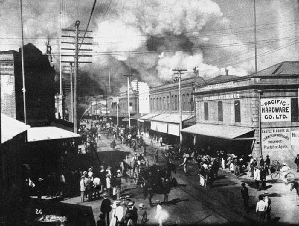 A fire in 1900 burned most of the Chinatown of Honolulu. The fire had been set to destroy houses suspected of being infected with bubonic plague. Hawaii State Archives.