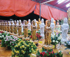 A photograph of rows of Buddha statues.