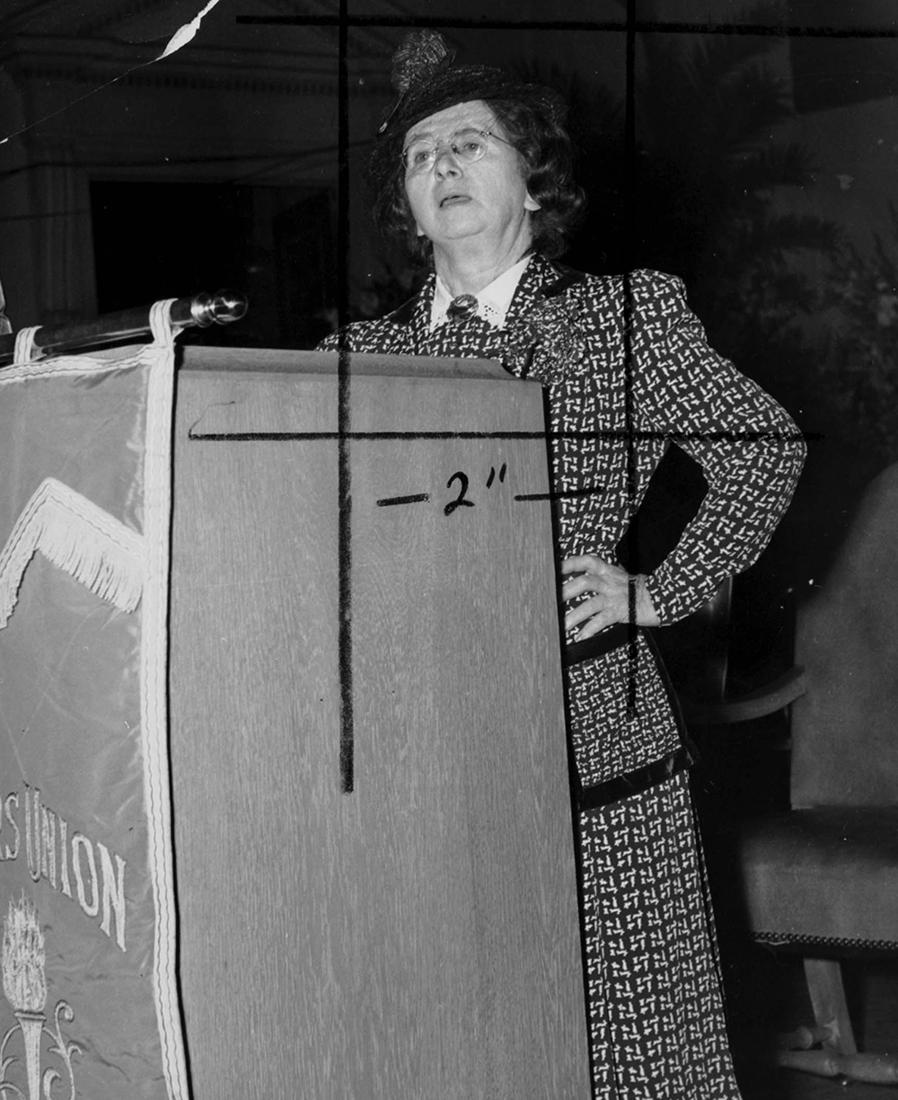 Rose Schneiderman speaks at a banner-draped podium. The Kheel Center for Labor-Management Documentation and Archives, International Ladies Garment Workers Union Photographs.