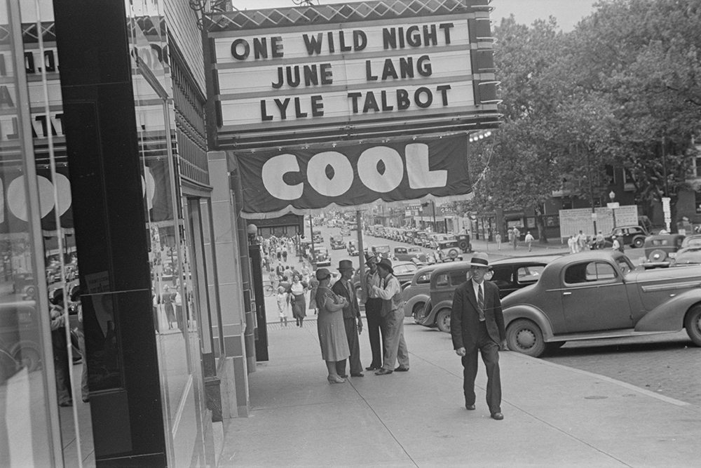 Photograph of a street scene showing a movie theater, probably in the vicinity of Lancaster, Ohio, by Ben Shahn, 1938.