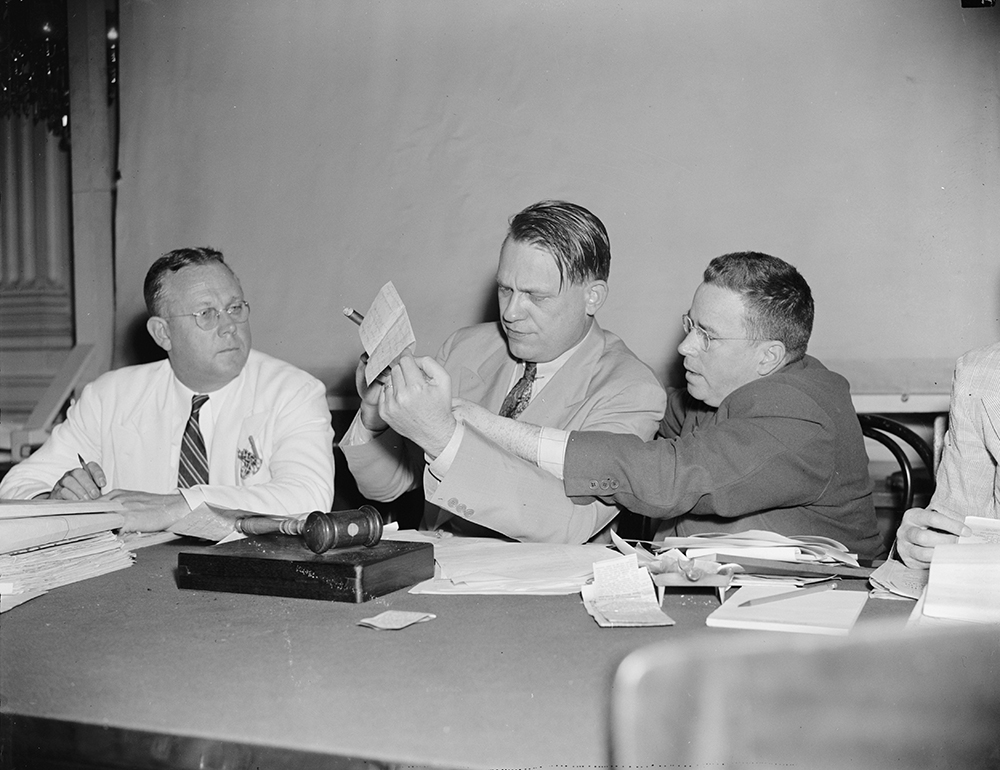 Photograph of the House Committee on Un-American Activities considering evidence against Hollywood by Harris & Ewing, 1938.