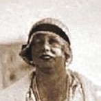 A woman wearing a 1930s hat.