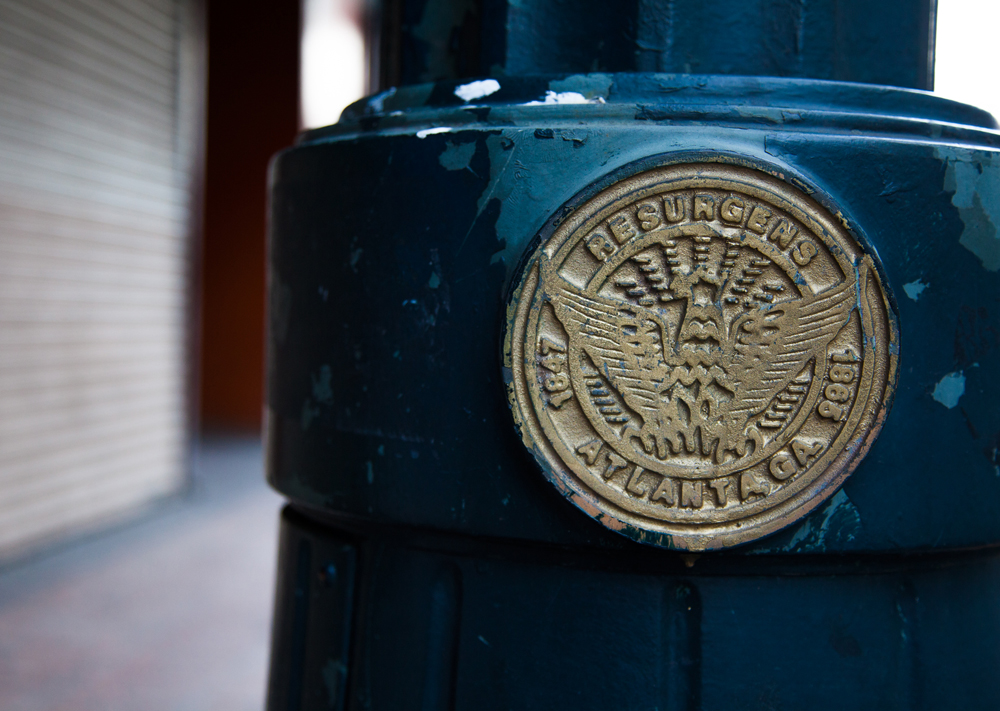 The evocative city seal appears not only on water meter covers, but on many streetlights as well. Photo by Artem Nazarov.