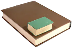 A small hardcover book on top of a large book
