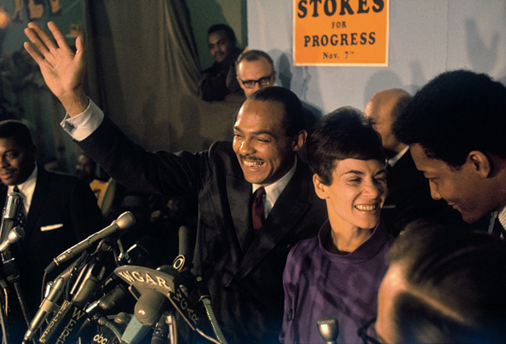 Carl Stokes with his wife, Shirley, acknowledges cheers of crowd at his campaign headquarters election night. Bettman/Getty Images.
