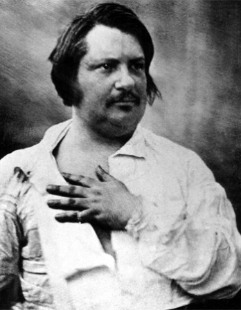 Image of French writer Honoré de Balzac with hand on chest.