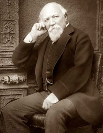 Black and white photograph of English poet Robert Browning seated.