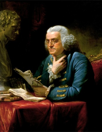 Painting of Benjamin Franklin reading a batch of papers next to a classical bust.