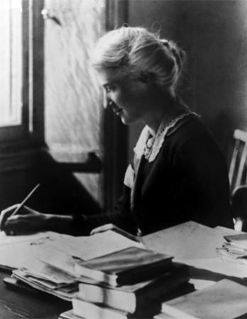 Black and white photograph of British social reformer Eglantyne Jebb at a desk.