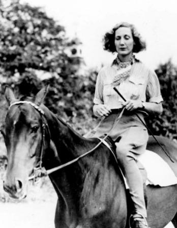 Photograph of pilot, horse trainer, writer, and adventurer Beryl Markham on horseback.