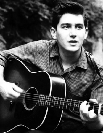 Black and white photograph of folksinger Phil Ochs.