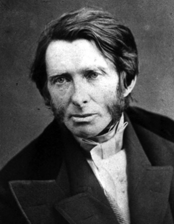 Black and white photograph of a young John Ruskin wearing a suit.