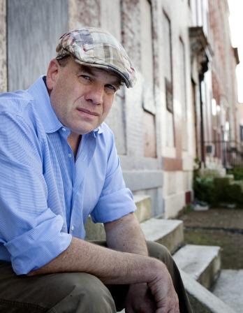 David Simon sitting outside wearing an Irish driver cap