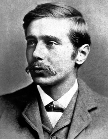 Black and white photograph of a young H.G. Wells with a mustache.