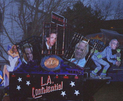 Krewe du Vieux float satirizing Louisiana politicians with legal problems, including former governor Edwin Edwards (second from right) and notorious state representative David Duke (second from left), both in prison at the time, 2003. Photograph by Infrog