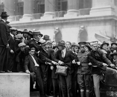 Soldiers and police establishing line at door of the Morgan Bank after anti-capitalist Wall Street bombing, September 16, 1920.