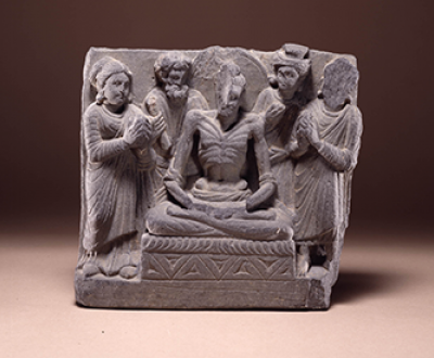 An emaciated Bodhisattva seated on a throne flanked by gods and worshippers, second to third century, Gandhara. The British Museum.