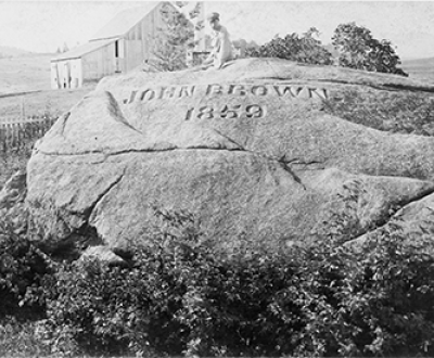 "John Brown's grave and the ""Big Rock,"" North Elba, New York, c. 1896. Photograph by Seneca Ray Stoddard. Library of Congress, Prints and Photographs Division."