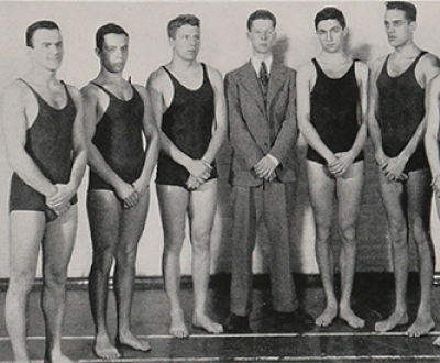 The 1938 Johns Hopkins swim team, with Murray Kempton (in suit) in center, from The Johns Hopkins Hullabaloo. Ferdinand Hamburger Archives, Sheridan Libraries, Johns Hopkins University.