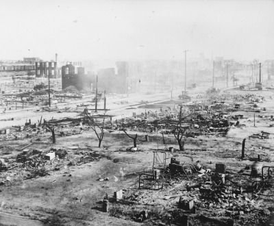 A photograph of the ruins of the Tulsa Race Massacre, showing the rubble of burned homes and businesses.