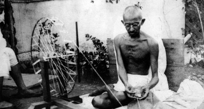 Mahatma Gandhi spinning yarn, in the late 1920s