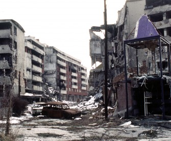 View of Grbavica, a neighbourhood of Sarajevo, approximately 4 months after the signing of the Dayton Peace Accord that officially ended the war in Bosnia, 1996. Photograph by Lt. Stacey Wyzkowski.