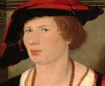 Renaissance youth wearing a hat.