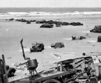 Abandoned British military vehicles on the beach of Dunkirk, France, 1940.