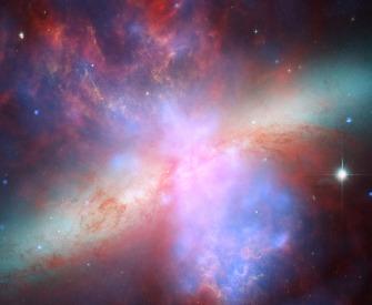 NASA image of the colorful starburst galaxy M82.